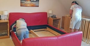 wimbledon removals dismantling a bed for removal.